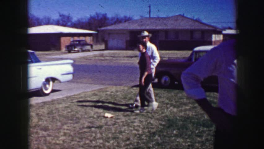 AMES, IOWA 1969: Cowboy hat wearing old man family arrival Easter classic powder blue car.