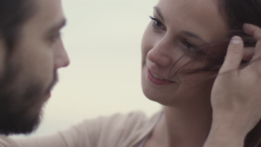 Attractive Couple Having Moment of Tenderness, Looking at Each Other. Shot on RED Cinema Camera in 4K (UHD).
