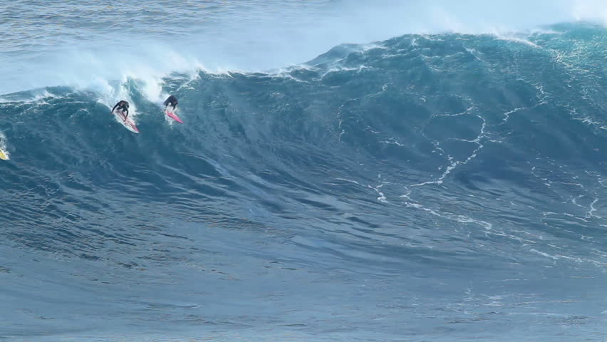 "MAUI, HI - January 31: Professional surfers ride a giant wave at the legendary big wave surf break known as ""Jaws"" during one the largest swells of the winter January 31, 2012 in Maui, HI."