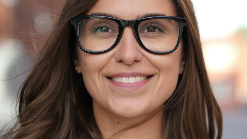 Close Up of Smiling Girl Face in Glasses, Outdoor | Shutterstock HD Video #19435699