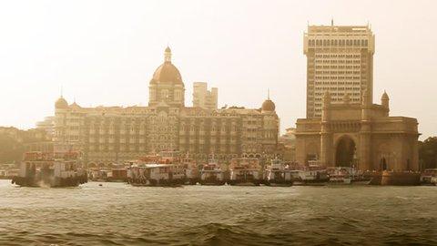 Boat ride leaving Mumbai's Gateway of India and Taj Mahal Hotel