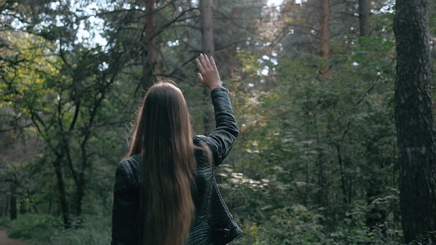 Girl throwing arms in Autumn in slow motion, smiling into the camera. Fashion pose in forest, smiling attractive brunette on a walk | Shutterstock HD Video #19555567