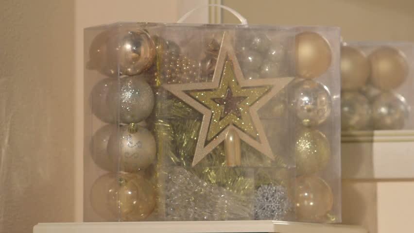 Classic Christmas tree gold silver ball ornaments set on a shelf | Shutterstock HD Video #19560697