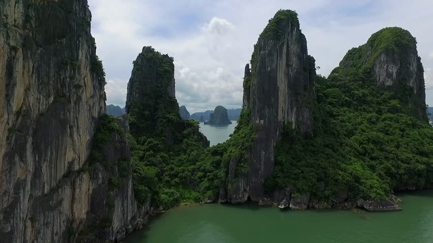 A suggestion aerial video in ha long bay, vietnam. An aerial video near the rocks, in a beautiful day.   Shutterstock HD Video #19601293