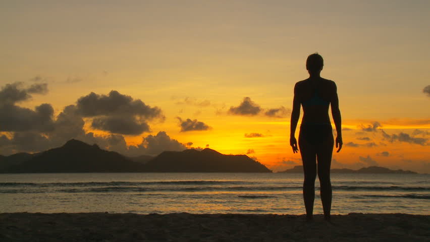 silhouette of woman exercising in sunset part II of II