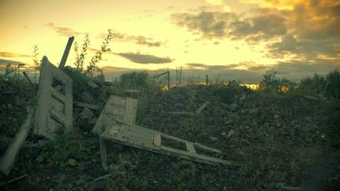 Apocalyptic landscape.The wreckage of the building at sunset