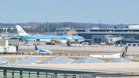 WASHINGTON DC - 2016: KLM Airbus A330 Parked at Gate Terminal Building Exterior of Dulles International Airport IAD