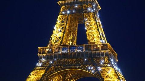 4k footage of illuminated Eiffel Tower at Paris, France at night.