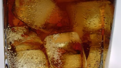 Coke with Ice in Whiskey Glass Close Up Panning Glass ( 4K )