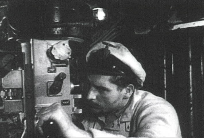 ATLANTIC OCEAN - CIRCA 1942-1944: World War II, German U-boat Captain Watching US Navy Ship Sink Through Periscope, publisher National Broadcasting Service (U.S.)