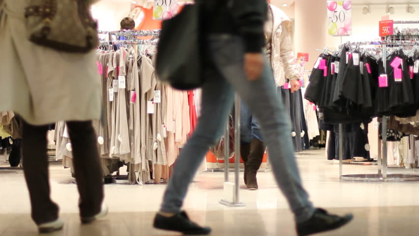 Woman picks clothes at the store