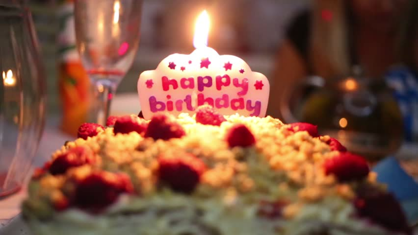 Lighting The Fire Of Candles On A Birthday Cake In The