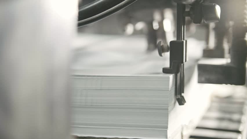 Printed sheets of paper are served in the printing press. Offset printing, CMYK