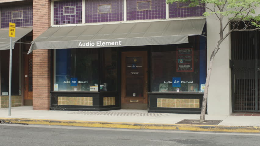 Day Quaint Storefront Large Glass Windows Small Awning Bottom Brick Bldg Reads Audio Elements Coffee