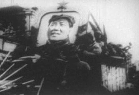 Mao Tse-tung, with troops and fanfare, proclaims the birth of the People\xCDs Republic of China on October 1, 1949. (1940s)