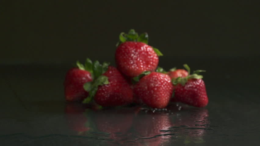 table top background hd. table top shot of many strawberries falling down on a wet - hd stock footage background hd