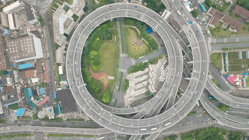 Overhead aerial view of the circular shaped Nanpu highway, one of the most iconic elevated highways, located in Shanghai, China.