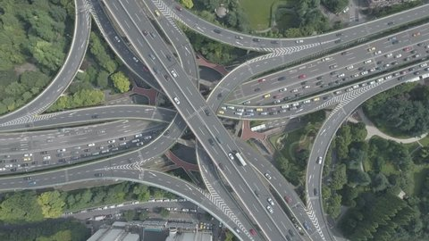 Massive intersection seen from above on a sunny day in Shanghai, China.
