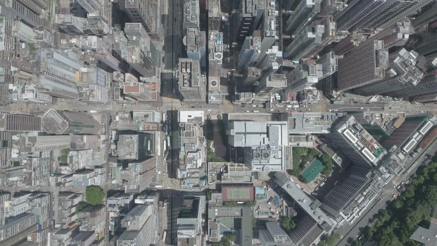 Abstract aerial drone footage of rooftops and streets in the densely populated Kowloon area in Hong Kong, one of Asia's most iconic modern cities. D-log profile on DJI Phantom.   Shutterstock HD Video #19844734
