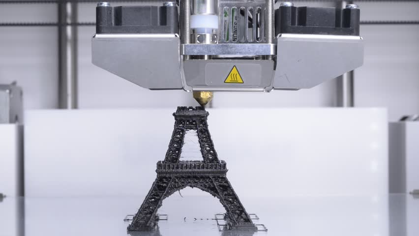 3D printer at work, printing the Eiffel Tower with black filament, shot in real time