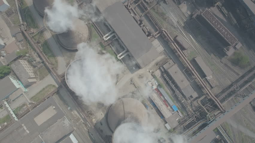 Overhead aerial view of coal fired reactors on the site of a large steel factory in Benxi, China. Huge amounts of smoke billow from the chimneys, creating air pollution.