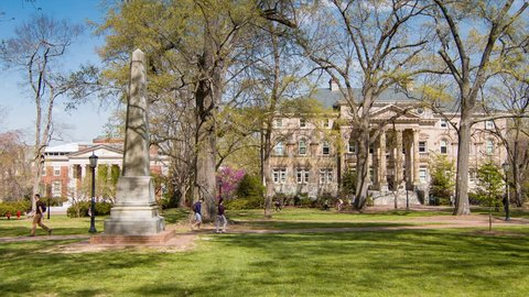 RALEIGH / DURHAM, NC - 2016: Anthropology Department Building Exterior with Davie Poplar at University of North Carolina Chapel Hill with Outside Scenery of Students Walking in McCorkle Place Park