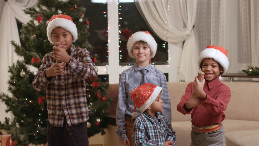kids with fire crackers boys near christmas tree lets celebrate loud holiday brings joy