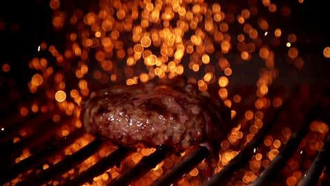 Cooking burger in slow motion
