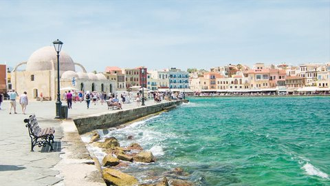CRETE, GREECE - 2016: Chania Crete Scenic Historical Greek Waterfront with Tourists Sightseeing and Exploring the Old Town Harbour on a Sunny Day in Summer