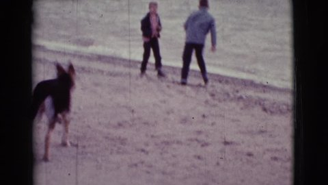 COTTONWOOD, ARIZONA 1968: two young lads frolicking at the beach with pet