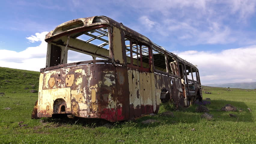 Dolly shot of the rusted auto bus