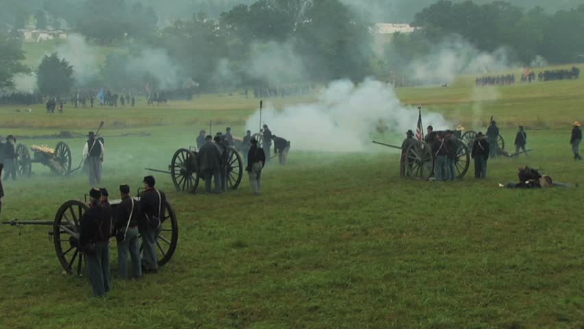 GETTYSBURG, PENNSYLVANIA - JULY 2008 - large-scale, epic Civil War anniversary reenactment -- in the middle of battle. Union and Confederate Artillery firing and fighting, cannons with smoke, explodes