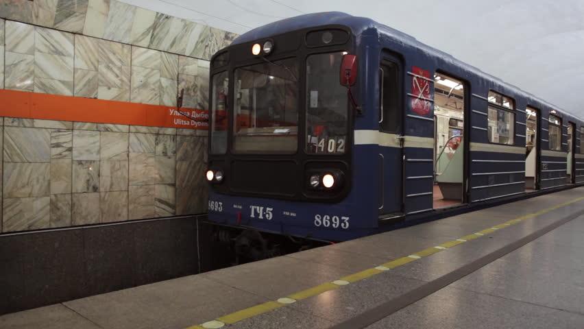 Metro train door close and train departs a subway station in Saint Petersburg Russia