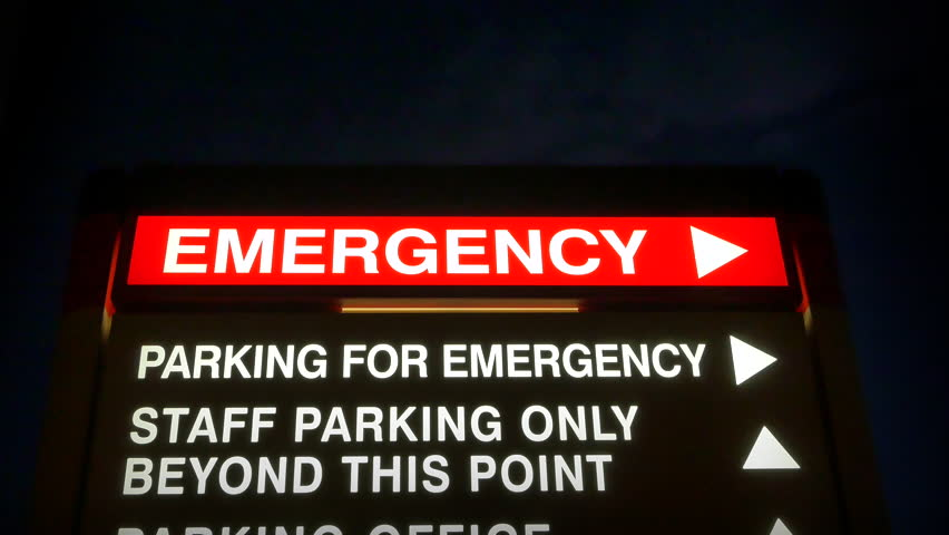 4K Arrow Pointing to Emergency Room at Hospital, Red Sign at Night