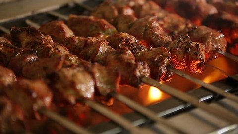 Cook roasts juicy kebab barbecue with crispy grilled slowmotion