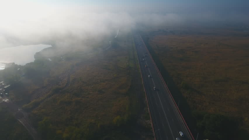 Autumn morning fog over highway. Aerial view.   Shutterstock HD Video #20053063