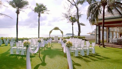 beautiful wedding setup on tropical beach background
