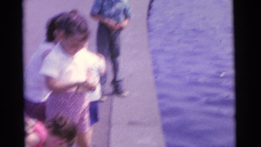CAMDEN, NEW JERSEY 1963: children throwing bread to the pond to feed the ducks | Shutterstock HD Video #20112247