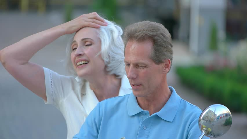 Woman leaning on man's shoulder. Mature couple is talking. Thanks for the day. Few important words. | Shutterstock HD Video #20131075