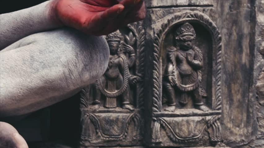 Sadhu meditating sitting in praying window. Closeup. Kathmandu Nepal