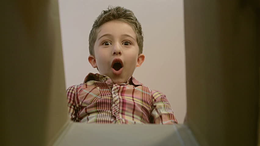 Little boy opens a parcel box with different versions of emotions and being surprised. | Shutterstock Video #20185195