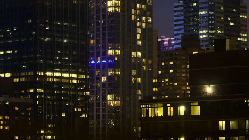 Office and Residential Buildings Windows Turn On and Off Time lapse Tilt Up 4k #20187157