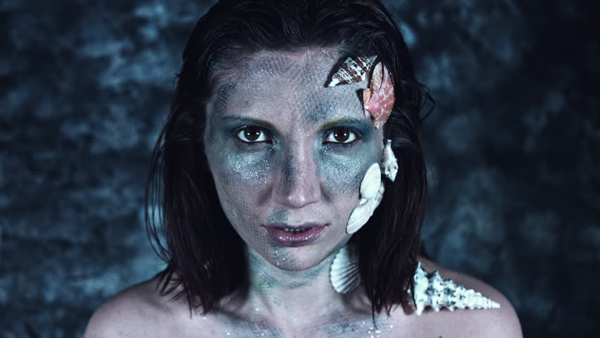 4k Halloween Shot of a Horror Woman Mermaid Posing with Vampire Teeth