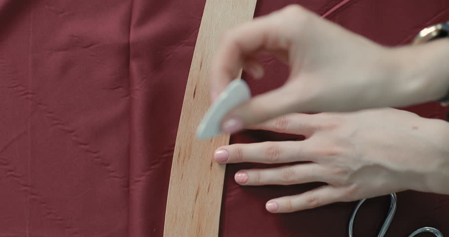 Close-up of a female designer hand. she decides where she was to hold the line on fabric. tracking shot. in slow motion | Shutterstock HD Video #20200267