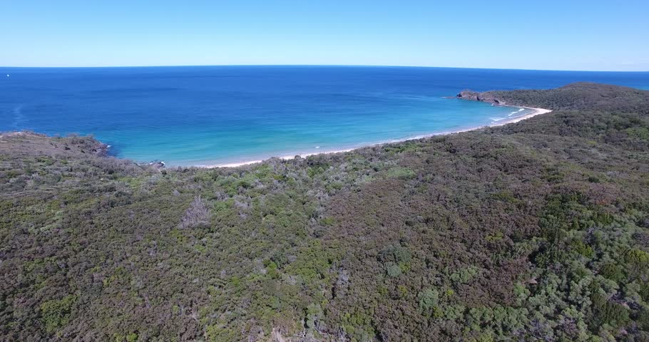 Aerial video of Alexandria Bay in Noosas National Park. View out towards sunshine beach. Location at the top of the sunshine coast Queensland Australia. Clear sky crystal waters.