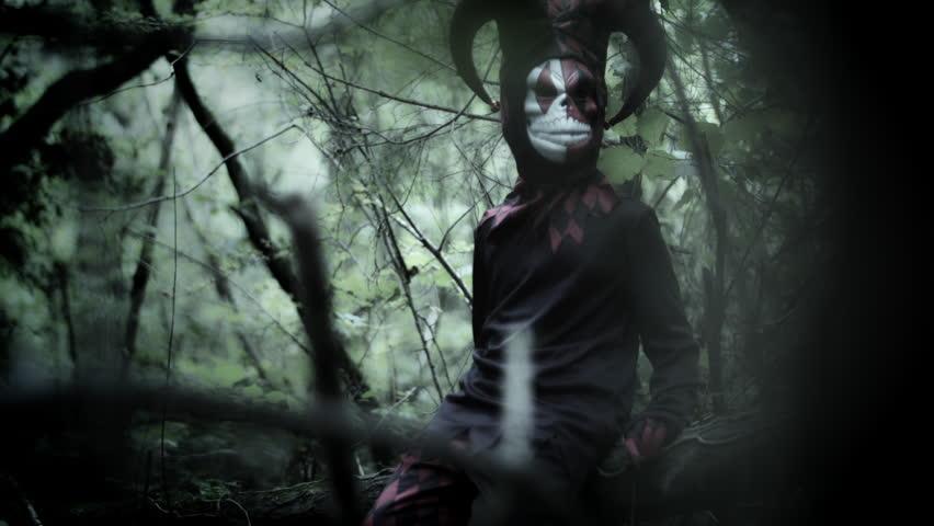 4k Halloween Shot of a Child in Joker Costume Turning to Camera