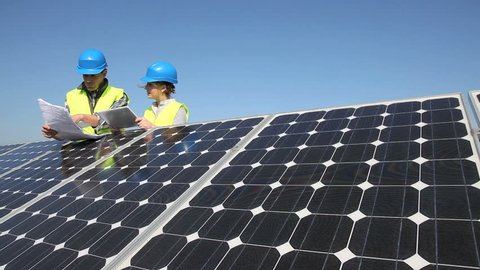 Engineers working on solar panels plant