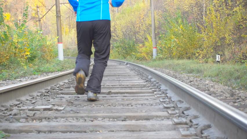 Feet Of Six Half-Naked Men Running At Autumn On Old Railway Stock Footage Video -1520