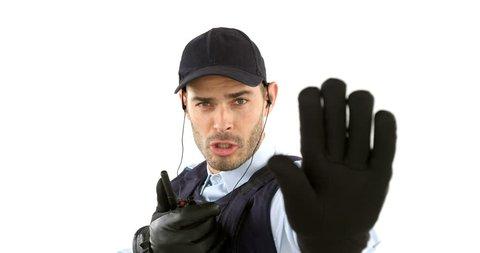 Security guard talking on walkie talkie on white background 4k