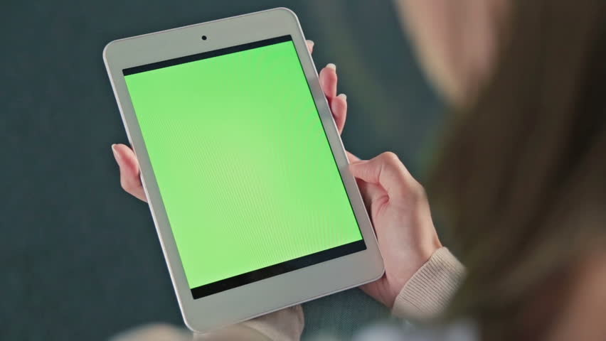 Woman looking at tablet with green screen. Close up shot of woman's hands with pad | Shutterstock HD Video #20329567